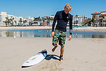 Surfer John John Florence warms up his ankle on the beach in Santa Monica, California September 30, 2015. <br /> CREDIT: Kendrick Brinson for The Wall Street Journal<br /> WORKOUT_florence