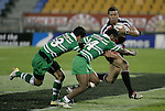 Siale Piutau is tackled by Tane Tuipulto & Simeli Tuiteci during the Air New Zealand rugby game between Counties Manukau Steelers & Manawatu, played at Mt Smart Stadium on the 22nd of September 2006. Counties Manukau 25 - Manawatu 25.