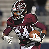 Trevor Yeboah-Kodie #24 of Garden City rushes for a long gain and a first down during the third quarter of the Nassau County Conference II varsity football semifinals against Calhoun at Hofstra University on Friday, Nov. 10, 2017. Yeboah-Kodie ran four four touchdowns, including a 76-yard run in the third quarter, in Garden City's 35-14 win.