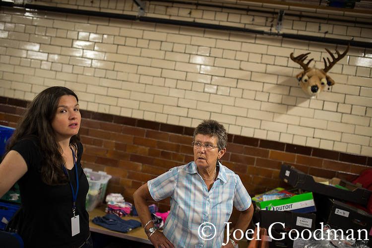 © Joel Goodman - 07973 332324 . 28 August 2013 . Wood Street Mission , Manchester , UK . L-R Development Worker Rachel Bywater (35 from Chorlton) and volunteer Wendy Witts (70 from Kearsley) (both correct) in the basement where incoming donations are sorted  . Photo credit : Joel Goodman