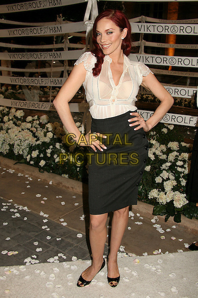 CARMIT BACHAR (of The Pussy Cat Dolls).Viktor & Rolf celebrate the launch of their collection for H&M - Red Carpet Arrivals, Bel Air, California, USA,.27 October 2006..full length hands on hips see through sheer white blouse shirt black high waisted pencil skirt bra pussycat.Ref: ADM/BP.www.capitalpictures.com.sales@capitalpictures.com.©Byron Purvis/AdMedia/Capital Pictures.