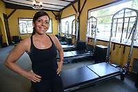 Patti Witt of Pilates Bodies by Patti Witt poses in her studio Thursday August 13, 2015 in Yardley Pennsylvania. (Photo by William Thomas Cain)