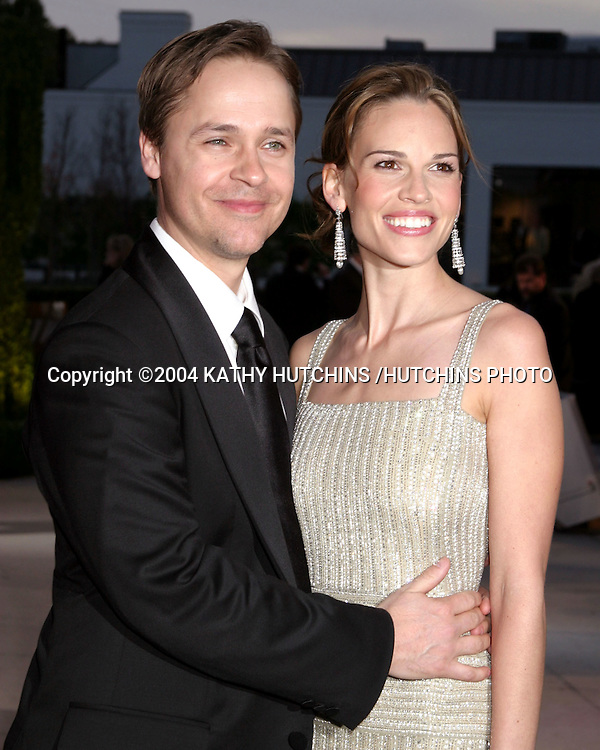 ©2004 KATHY HUTCHINS /HUTCHINS PHOTO.VANITY FAIR OSCAR PARTY.MORTONS RESTAURANT.WEST HOLLYWOOD, CA .FEBRUARY 29, 2004 ..CHAD LOWE AND HILARY SWANK..