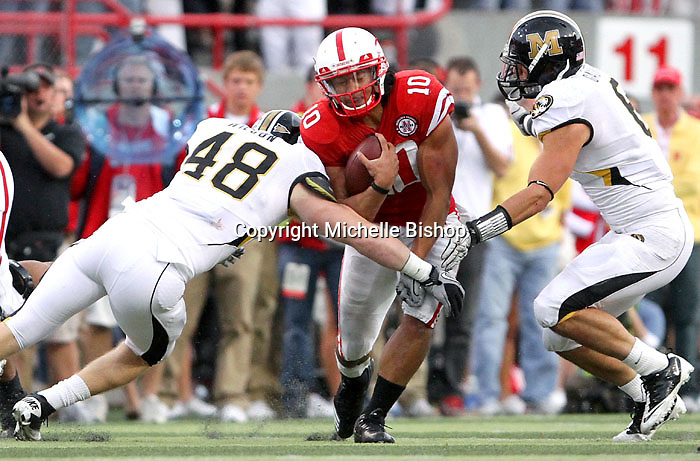 Nebraska I-back Roy Helu Jr.(10) fights for extra yardage as Missouri linebackers Andrew Wilson (48) and Andrew Gachkar (6) attempt to bring him down during the second half. Helu rushed for a school-record 307 yards on 28 carries. No. 14 Nebraska beat  No. 7 Missouri 31-17 at Memorial Stadium in Lincoln, Nebraska.
