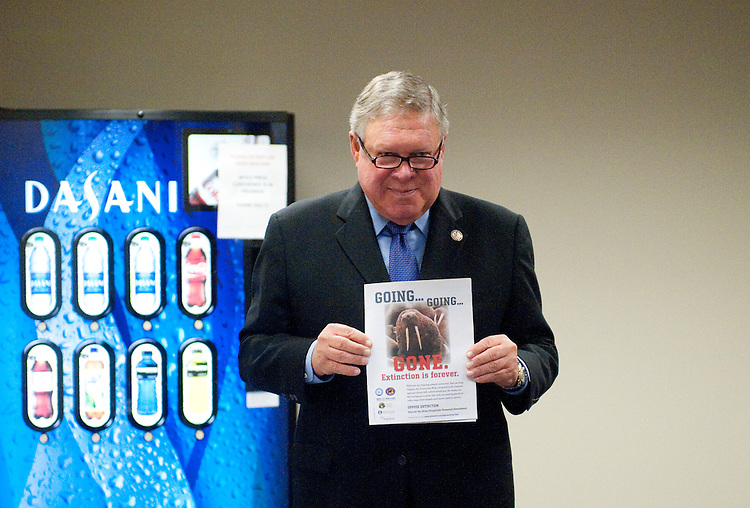 UNITED STATES - JULY 25: House Appropriations Committee ranking Democrat Rep. Norman Dicks, D-Wash. holds up a magazine ad about extinction as he waits for other members to arrive for their news conference on Monday, July 25, 2011, on H.R.2584, the FY2012 Interior, Environment and Related Agencies Appropriations Act. (Photo By Bill Clark/Roll Call)