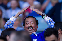 Cardiff owner Vincent Tan celebrates promotion with an Ayatollah celebration after the Sky Bet Championship match between Cardiff City and Reading at the Cardiff City Stadium, Cardiff, Wales on 6 May 2018. Photo by Mark  Hawkins / PRiME Media Images.