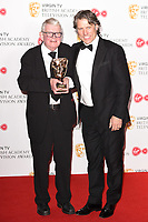 John Motson and John Bishop<br /> in the winners room for the BAFTA TV Awards 2018 at the Royal Festival Hall, London<br /> <br /> ©Ash Knotek  D3401  13/05/2018