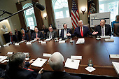 United States President Donald J. Trump, center, speaks during a Cabinet Meeting at the White House in Washington, DC on October 21, 2019. Pictured from left to right:  acting Director, Office of Management and Budget (OMB) Russell Vought, US Secretary of Education Betsy DeVos, US Secretary of the Interior David Bernhardt, Administrator of the United States Environmental Protection Agency Andrew Wheeler, US Secretary of Health and Human Services (HHS) Alex Azar, The President, and US Secretary of State Mike Pompeo.<br /> Credit: Yuri Gripas / Pool via CNP