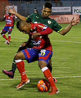PASTO - COLOMBIA -09-02-2017: Harrison Canchimbo (Izq.) jugador de Deportivo Pasto disputa el balón con Diego Valoyez (Der.) jugador de La Equidad, durante partido Deportivo Pasto y La Equidad, por la fecha 2 de la Liga Aguila I 2017, jugado en el estadio Departamental Libertad de la ciudad de Pasto.  / Harrison Canchimbo (L) player of Deportivo Pasto fights for the ball with Diego Valoyez (R) player of La Equidad, during a match Deportivo Pasto and La Equidad, for the date 2 of the Liga Aguila I 2017 at the Departamental Libertad stadium in Pasto city. Photo: VizzorImage. / Leonardo Castro / Cont.