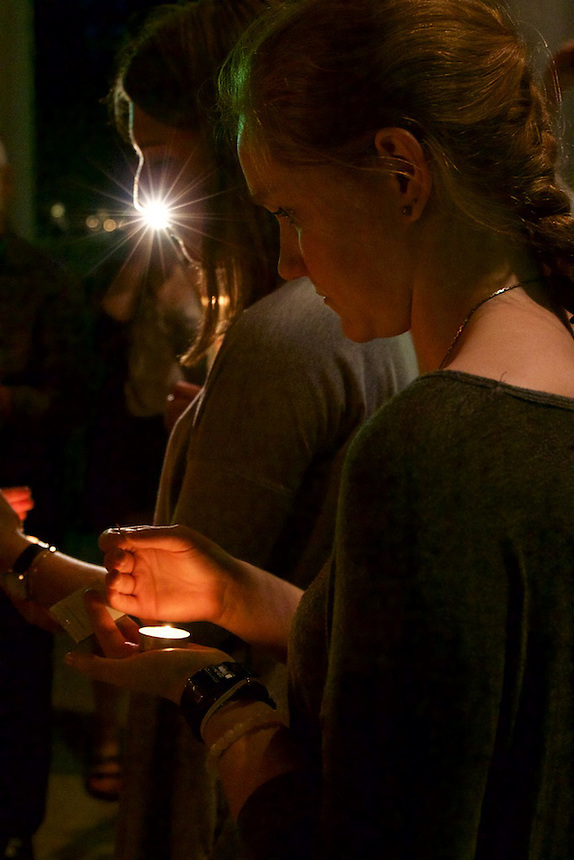 Alexandra Howard '17 and Isabel Macomber '17 light candles at Emerson's 9/11 Vigil on the Boston Common.
