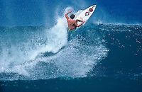 The late Ronnie Burns (HAW) surfing at Rocky Point, North Shore , Oahu, Hawaii. circa 1989 Photo: joliphotos.com.