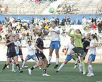 Allie Long #9 of the Washington Freedom is beaten to the ball by Lauren Cheney #8 and Ashley Phillips #24 of the Boston Breakers during a WPS match on May 8 2010, at the Maryland Soccerplex, in Boyds, Maryland. The game ended in a 0-0 tie.
