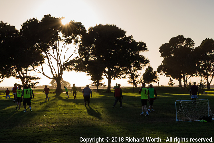 Late on a Tuesday afternoon, everyday athletes compete in a soccer game at the San Leandro Marina Park.