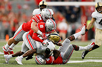 Ohio State Buckeyes safety Jordan Fuller (4), cornerback Kendall Sheffield (8), and linebacker Tuf Borland (32) team up to tackle Army Black Knights quarterback Ahmad Bradshaw (17) during the third quarter of the NCAA football game at Ohio Stadium in Columbus on Sept. 16, 2017. [Adam Cairns / Dispatch]