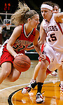 SIOUX CITY, IA - MARCH 14, 2009 --  Kallie Benike #32 of Davenport University drives toward Kristi Boehm #15 of Northwestern College during their 2009 NAIA DII Women's Basketball National Championship quarterfinal game Saturday at the Tyson Events Center in Sioux City. (Photo by Dick Carlson/Inertia)