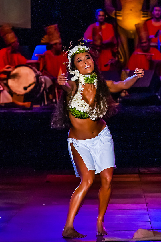 A Polynesian dancer  performing during  the Winners Showcase, the final night of Heiva i Tahiti (July cultural festival), Place Toata, Papeete, Tahiti, French Polynesia.