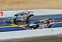 Jul. 18, 2010; Sonoma, CA, USA; NHRA funny car driver Matt Hagan (near) defeats John Force in round two during the Fram Autolite Nationals at Infineon Raceway. Mandatory Credit: Mark J. Rebilas-