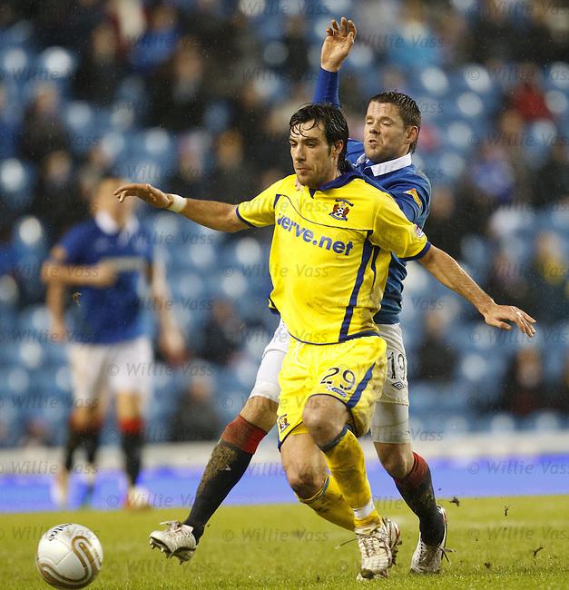 Manuel Pascali keeps James Beattie behind him