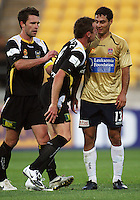 Phoenix captain Tim Brown (left) steps in as Shane Smeltz has words with Newcastle's Adam D'Apuzzo during the A-League match between Wellington Phoenix and Newcastle Jets at Westpac Stadium, Wellington, New Zealand on Sunday, 4 January 2009. Photo: Dave Lintott / lintottphoto.co.nz