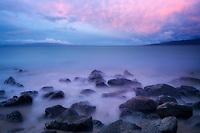 Ocean, rocks, sunrise and Kaho'olehu Island. Maui, Hawaii