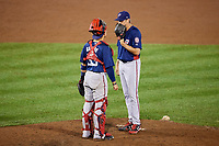 Potomac Nationals relief pitcher James Bourque (38) talks with catcher Tres Barrera (33) during a mound visit during the second game of a doubleheader against the Salem Red Sox on June 11, 2018 at Haley Toyota Field in Salem, Virginia.  Potomac defeated Salem 4-0.  (Mike Janes/Four Seam Images)