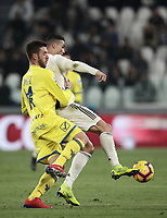 Calcio, Serie A: Juventus - Chievo Verona, Turin, Allianz Stadium, January 21, 2019.<br /> Juventus' Cristiano Ronaldo (r) in action with Chievo's Mattia Bani (l) during the Italian Serie A football match between Juventus and Chievo Verona at Torino's Allianz stadium, January 21, 2019.<br /> UPDATE IMAGES PRESS/Isabella Bonotto