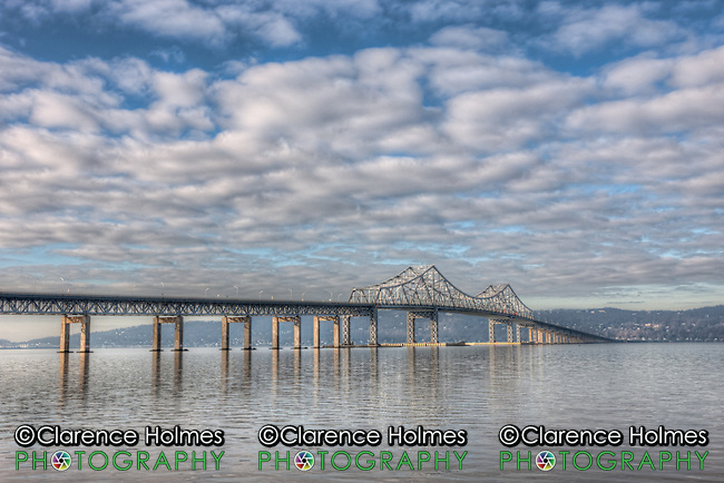 The Tappan Zee Bridge spans the Hudson River on a partly cloudy morning as seen from Tarrytown, New York, USA