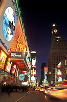 New York City, Manhattan, New York, Time Square illuminated at night (evening) along Broadway in Mid town Manhattan.