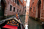 Riding a gondola down a canal in Venice, Italy