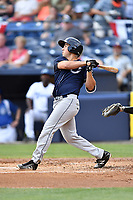 Charleston RiverDogs third baseman Mandy Alvarez (21) swings at a pitch during a game against the Asheville Tourists at McCormick Field on July 4, 2017 in Asheville, North Carolina. The Tourists defeated the RiverDogs 2-1. (Tony Farlow/Four Seam Images)