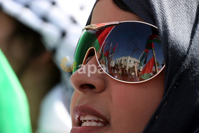 Palestinians take part in a rally marking the Land Day in the West Bank city of Ramallah, March 30, 2011. The Palestinians mark March 30 as the Land Day to remember the deaths of six Arabs in the hands of Israeli forces when they were protesting the annexation of Palestinian land in 1976. Photo by Issam Rimawi