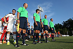 24 June 2014: Match officials (in green, from left): assistant referee Bill Ditmar, Referee Fotis Bazakos, Fourth Official Jose Carlos Rivero, and Mark Cahen. With Los Angeles' Robbie Keane (IRL) (left). The Carolina RailHawks of the North American Soccer League played the Los Angeles Galaxy of Major League Soccer at Koka Booth Stadium at WakeMed Soccer Park in Cary, North Carolina in the fifth round of the 2014 Lamar Hunt U.S. Open Cup soccer tournament. The RailHawks won the game 1-0 in overtime.