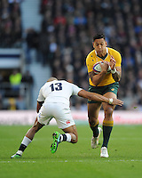 Israel Folau of Australia tackled by Jonathan Joseph of England during the Old Mutual Wealth Series match between England and Australia at Twickenham Stadium on Saturday 3rd December 2016 (Photo by Rob Munro)