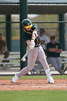 Oakland Athletics center fielder Austin Beck (18) at bat during a Minor League Spring Training game against the Chicago Cubs at Sloan Park on March 13, 2018 in Mesa, Arizona. (Zachary Lucy/Four Seam Images)