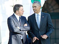 United States President Barack Obama, right, and Prime Minister Matteo Renzi of Italy, left, engage in light conversation during an Official Arrival Ceremony in honor of the Prime Minister on the South Lawn of the the White House in Washington, DC on Tuesday, October 18, 2016. <br /> Credit: Ron Sachs / CNP /MediaPunch