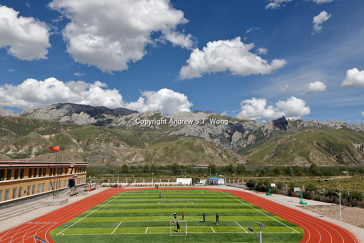 Nangqen County, Yushu Tibetan Autonomous Prefecture, Qinghai Province, China - A game of soccer at a local vocational training school, August 2019.