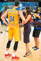 Herbalife Gran Canaria's player Pablo Aguilar and sport journalist Milena Martin during the final of Supercopa of Liga Endesa Madrid. September 24, Spain. 2016. (ALTERPHOTOS/BorjaB.Hojas) NORTEPHOTO.COM