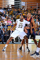 25 February 2012:  FIU center Brandon Moore (22) boxes out South Alabama guard-forward Mychal Ammons (13) in the first half as the FIU Golden Panthers defeated the University of South Alabama Jaguars, 81-74, at the U.S. Century Bank Arena in Miami, Florida.