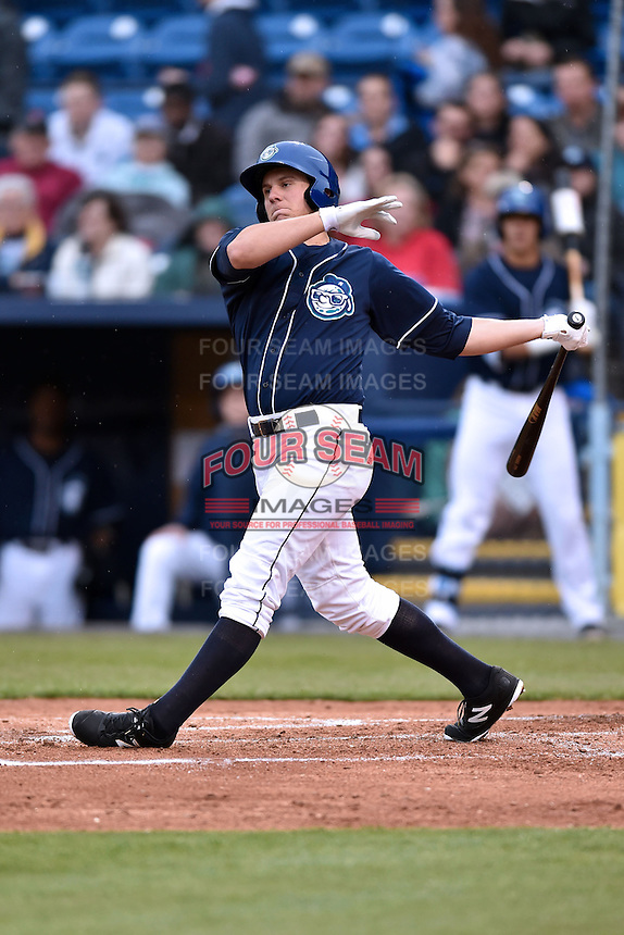 Asheville Tourists third baseman Kevin Padlo (15) swings at a pitch during a game against the Greenville Drive on April 16, 2015 in Asheville, North Carolina. The Tourists defeated the Drive 5-4. (Tony Farlow/Four Seam Images)