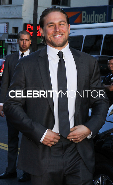 """[(FILE) Actor Charlie Hunnam has dropped out of the lead role of character Christian Grey in the """"Fifty Shades of Grey"""" (2014) film adaptation. """"The filmmakers of 'Fifty Shades of Grey' and Charlie Hunnam have agreed to find another male lead given Hunnam's immersive TV schedule which is not allowing him time to adequately prepare for the role of Christian Grey,"""" Universal Pictures said in a statement, obtained by The Hollywood Reporter.] HOLLYWOOD, CA - SEPTEMBER 07: Actor Charlie Hunnam at the Premiere Of FX's """"Sons Of Anarchy"""" Season 6 held at the Dolby Theatre on September 7, 2013 in Hollywood, California. (Photo by Rudy Torres/Celebrity Monitor)"""