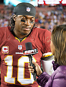 Washington Redskins quarterback Robert Griffin III is interviewed as he leaves the field following his team's 17 - 16 victory over the New York Giants at FedEx Field in Landover, Maryland on Monday, December 3, 2012.  .Credit: Ron Sachs / CNP