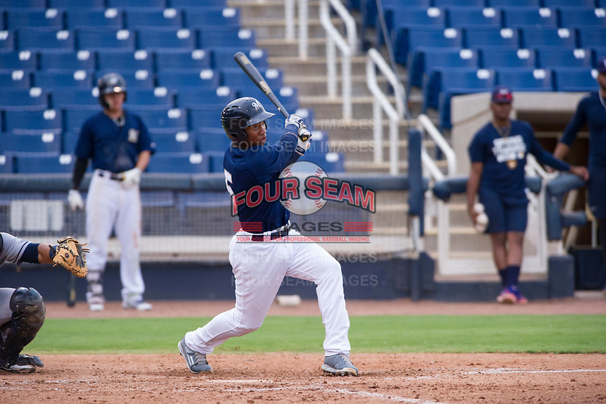 AZL Brewers shortstop Jean Carmona (5) follows through on his swing against the AZL Padres 2 on September 2, 2017 at Maryvale Baseball Park in Phoenix, Arizona. AZL Brewers defeated the AZL Padres 2 2-0. (Zachary Lucy/Four Seam Images)