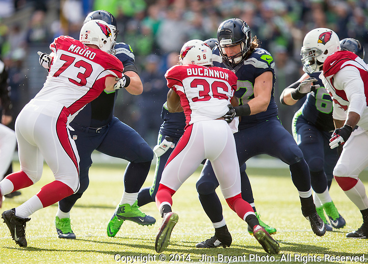 Seattle Seahawks right tackle Justin Britt (68) and tight end Luke Willson (82) blocks Arizona Cardinals  defensive end Josh  Mauro (73) and cornerback Antionio Comartie (31) at CenturyLink Field in Seattle, Washington on November 23, 2014. The Seahawks beat the Cardinals 19-3.   ©2014. Jim Bryant Photo. All Rights Reserved.