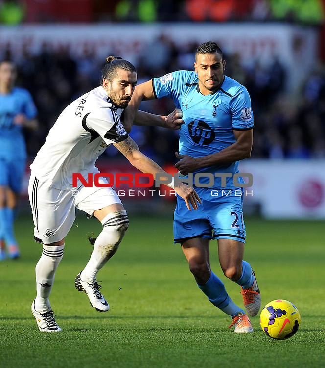 Tottenham Hotspur's Nacer Chadli battles for the ball with Swansea City's Chico -   19/01/2014 - SPORT - FOOTBALL - Liberty Stadium - Swansea - Swansea City v Tottenham Hotspur - Barclays Premier League<br /> Foto nph / Meredith<br /> <br /> ***** OUT OF UK *****