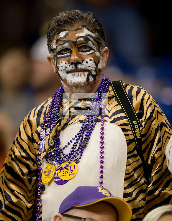 LSU fan is pictured with tiger makeup before BCS National Championship game at Mercedes-Benz Superdome in New Orleans, Louisiana on January 9th, 2012.   Alabama defeated LSU, 21-0.