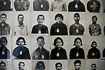 Mugshots of prisoners taken upon their arrival are on display at the Tuol Sleng prison in Phnom Penh, Cambodia. An estimated 17,000 people passed through Tuol Sleng, where all but a handful were brutally interrogated, made to confess to a list of crimes against the regime and then murdered in the infamous Killing Fields. About 6,000 of these photographs  survived after Vietnamese military forces ousted the Khmer Rouge in 1979. All of those images are on display today at what is now known as the Tuol Sleng Genocidal Museum. March 1, 2012.