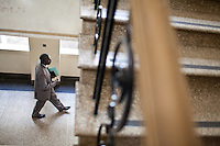 Detective patrick Simiyu leaveing the Law Courts after delivering his case files in advance of a  legal hearing.