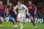 Stuttgart's Aleksandr Hleb against Barcelona's Dani Alves and Thierry Henry during UEFA Champions League match. March 17, 2010. (ALTERPHOTOS/Tati Quinones)