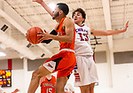 WOODBURY, CT. 03 January 2020-010320BS264 - Trryville's Harold Garcia (10) goes up and under against the defense of Nonnewaug's Jon Khazzaka (13), during a BL basketball game between Terryville and Nonnewaug at Nonnewaug High School in Woodbury on Friday. Bill Shettle Republican-American