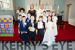 Pupils from Scoil an Ghleanna who made their First Holy Communion in The Sacred Heart Church on Saturday pictured here front l-r; Aodhán Ó Mongáin, Jack Ó Céilleachair, Dáithí Ó Sé, Meabh Ní Shúilleabháin, middle l-r; Conor Ó Siochrú, Sean Ó Súilleabháin, Tadhg Ó Laoire, Hannah Ní Mhurchú, back l-r; Luke Harty, Múinteoir Louise Ní Shé, Fr David Gunn & Dylan Ó Connaill.